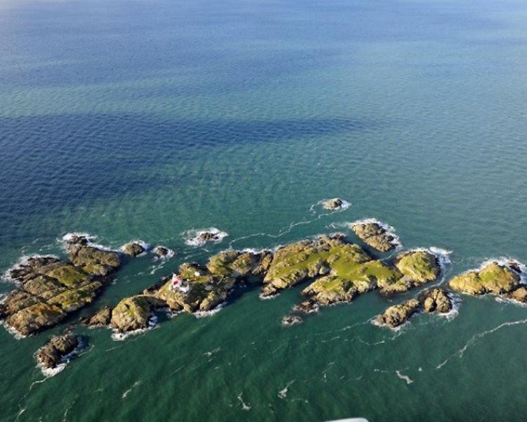 The remote Skerries islet off Anglesey, home to a lighthouse, historic buildings and fragile archaeological earthworks. The Skerries is managed by the RSPB for its bird populations during the summer months.